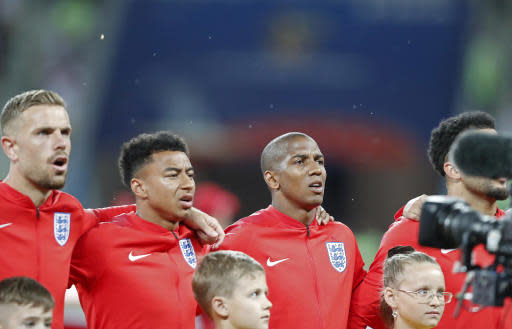 Flies surround the English team during the anthem prior the group G match between Tunisia and England at the 2018 soccer World Cup in the Volgograd Arena in Volgograd, Russia, Monday, June 18, 2018. (AP Photo/Frank Augstein)