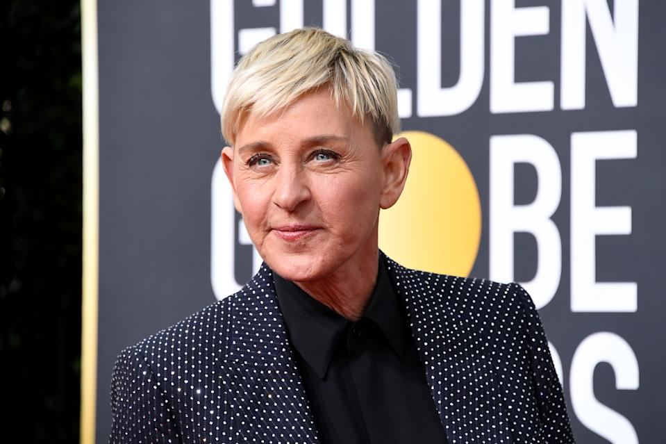 "Ellen DeGeneres says she's feeling good amid COVID-19 diagnosis, but has ""bad"" back pain. Here she is at the 2020 Golden Globe Awards in January."