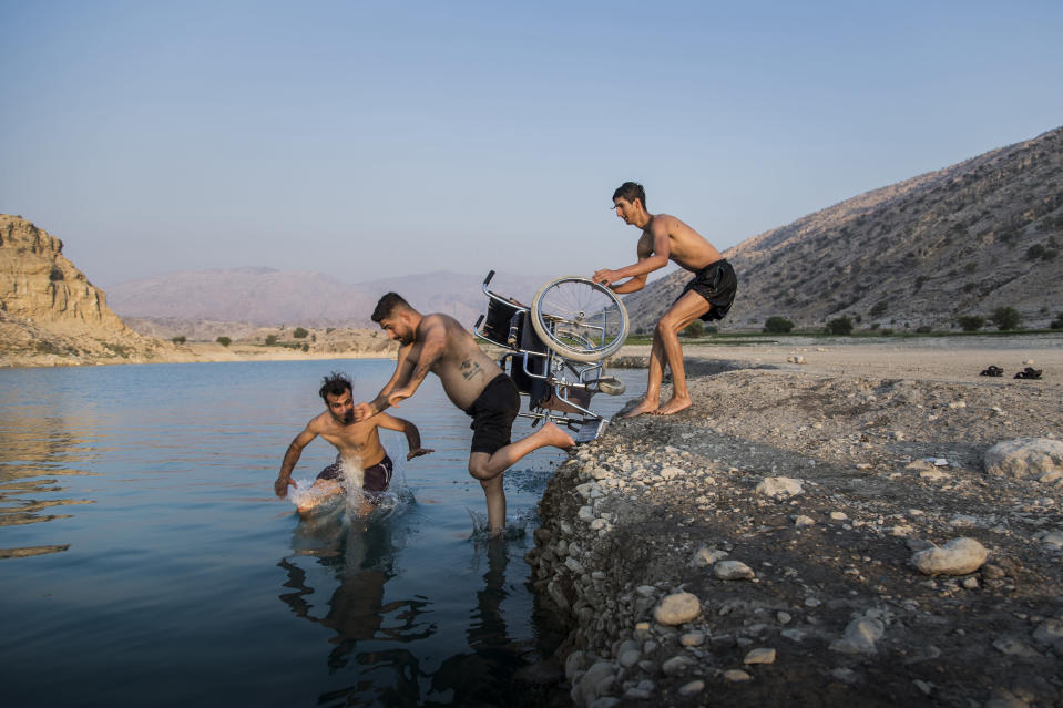 In this image released by World Press Photo, Thursday April 15, 2021, by Fereshteh Eslahi, Podium Photos, titled Thoughts of Flight, part of a series which won third prize in the Sports Stories category, shows Saeed Ramin, a professional traceur (practitioner of parkour) enjoys time with friends at Kosar Dam Lake, near Gachsaran, Iran, on Sept. 9, 2020. (Fereshteh Eslahi, Podium Photos, World Press Photo via AP)
