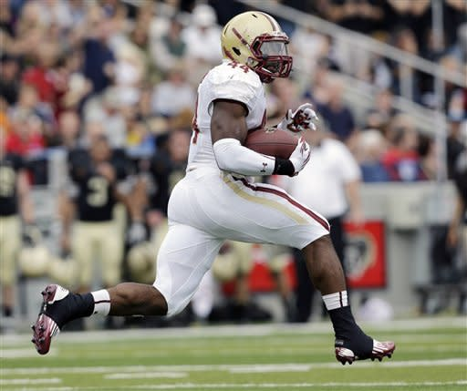 Boston College running back Andre Williams (44) breaks away from Army defenders for a 99-yard touchdown run during the first half of an NCAA college football game Saturday, Oct. 6, 2012, in West Point, N.Y. (AP Photo/Mike Groll)