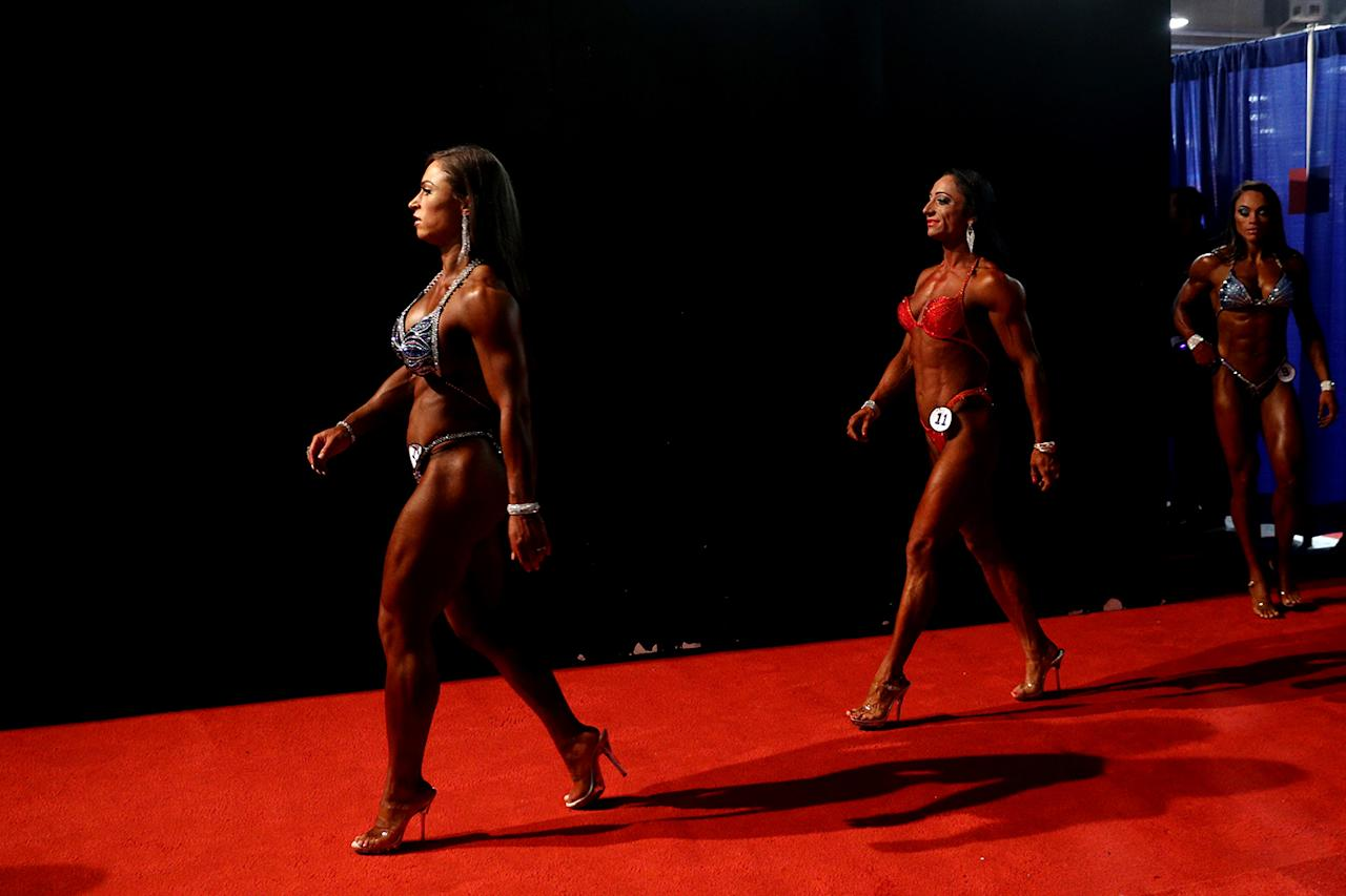 <p>Figure International contestants walk backstage at the Greater Columbus Convention Center during the Arnold Sports Festival 2017 on March 3, 2017 in Columbus, Ohio. (Photo: Maddie Meyer/Getty Images) </p>