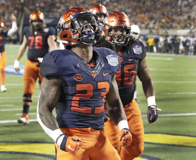 Syracuse running back Abdul Adams (23) celebrates after scoring a touchdown on a 1-yard run against West Virginia during the first half of the Camping World Bowl NCAA college football game Friday, Dec. 28, 2018, in Orlando, Fla. (AP Photo/John Raoux)