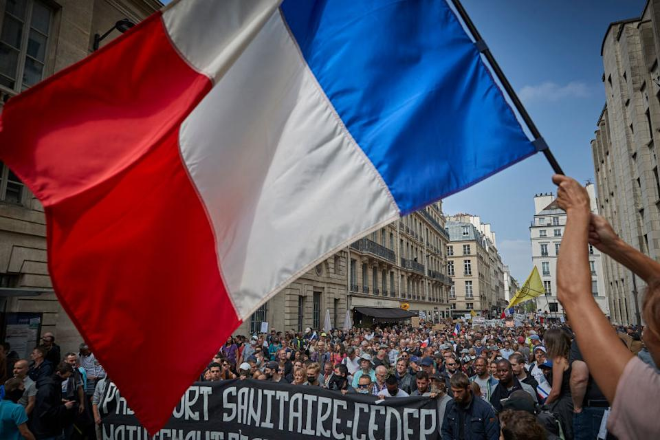 Thousands of anti-vaccine demonstrators march through the streets of Paris. Source: Getty