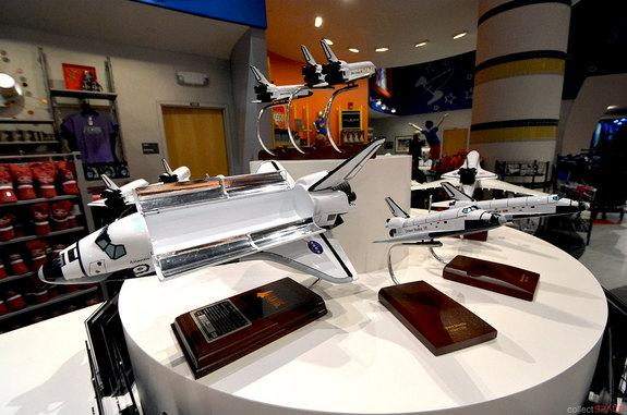 Space shuttle Atlantis models, including a limited edition model signed by Atlantis' final commander Chris Ferguson, are offered by the Kennedy Space Center Visitor Complex in Florida.