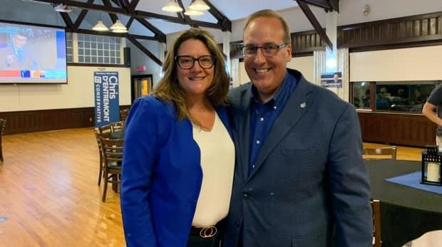 Conservative Chris d'Entremont (right) with his wife on Monday night. d'Entremont kept his seat in West Nova and is no longer the only federal Conservative in Nova Scotia after at least two others won their races. (Héloïse Rodriguez-Qizilbash/CBC - image credit)