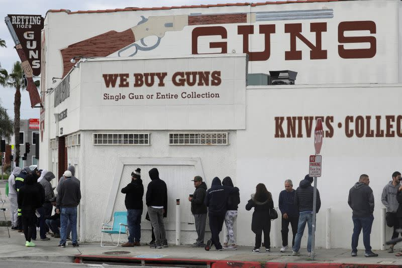 FILE PHOTO: People wait in line outside to buy supplies at the Martin B. Retting, Inc. gun store amid fears of the global growth of coronavirus cases, in Culver City