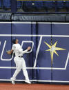 Tampa Bay Rays right fielder Hunter Renfroe looks up as a two-run home run hit by Boston Red Sox's Alex Verdugo clears the fence during the fourth inning of a baseball game Wednesday, Aug. 5, 2020, in St. Petersburg, Fla. (AP Photo/Steve Nesius)