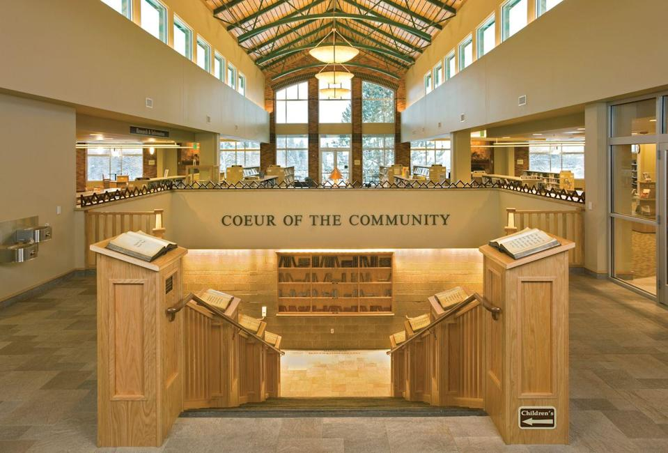 """<p>The town of Coeur D'alene is named after a neighboring lake, so it's fitting that its <a href=""""http://www.cdalibrary.org"""" rel=""""nofollow noopener"""" target=""""_blank"""" data-ylk=""""slk:public library"""" class=""""link rapid-noclick-resp"""">public library</a> has views straight to the water. The neutral-hued library, which opens up onto a neighboring park, also won an <a href=""""http://idaholibraries.org/award-and-scholarship-winners-year/"""" rel=""""nofollow noopener"""" target=""""_blank"""" data-ylk=""""slk:Idaho Library of the Year Award"""" class=""""link rapid-noclick-resp"""">Idaho Library of the Year Award</a> in 2012. </p>"""