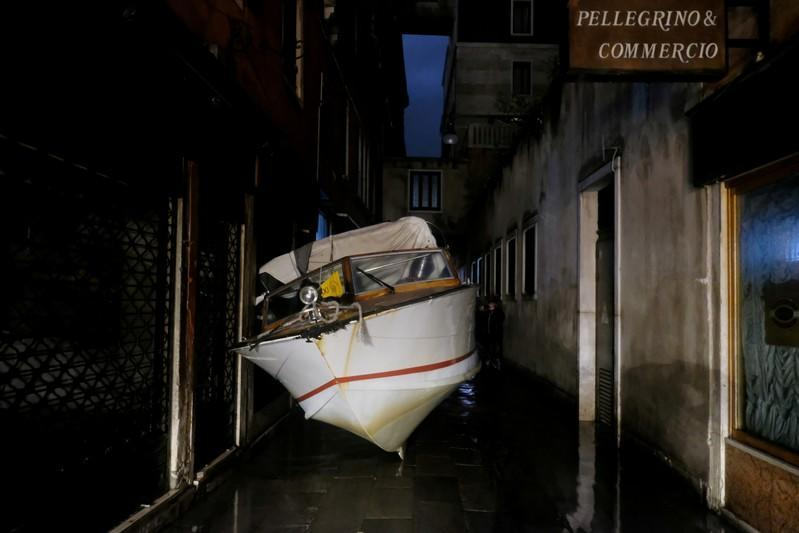 A water taxi transported by floods into a street during a night of record-high flooding is seen in Venice, Italy