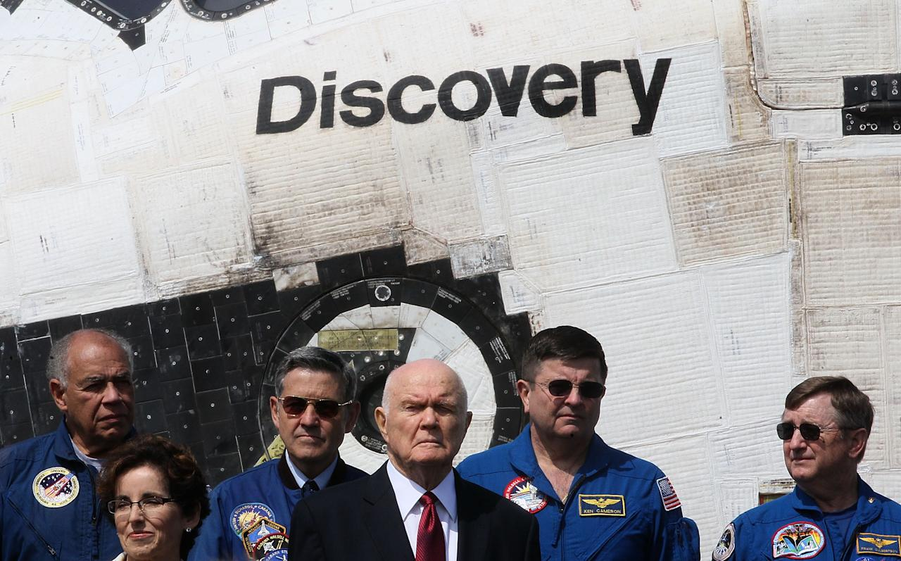 Former Astronaut and former U.S. Senator John Glenn (D-OH) stands in front of the Space Shuttle Discovery during an event at the Smithsonian National Air and Space Museum Steven F. Udvar-Hazy Center April 19, 2012 in Chantilly, Virginia. The space shuttle Discovery is the he oldest and most traveled vehicle from NASA's space shuttle program, and will replace the Interprise at the museum.  (Photo by Mark Wilson/Getty Images)