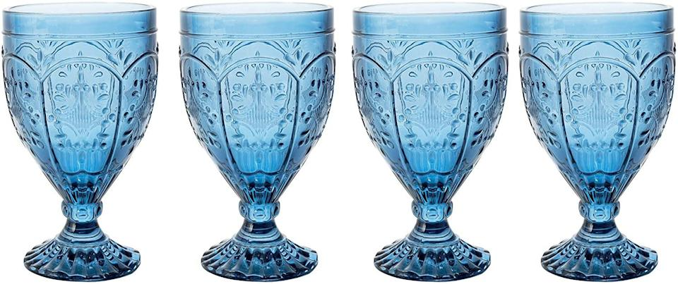 """<h3>Embossed Stemware Set</h3><br>You don't have to let your dinner guests in on the little secret that these embossed glass treasures weren't actually scored at a hidden-gem vintage shop.<br><br><strong>Fitz and Floyd</strong> Trestle Glassware Ornate Goblets, Set of 4, $, available at <a href=""""https://amzn.to/37OrJxk"""" rel=""""nofollow noopener"""" target=""""_blank"""" data-ylk=""""slk:Amazon"""" class=""""link rapid-noclick-resp"""">Amazon</a>"""