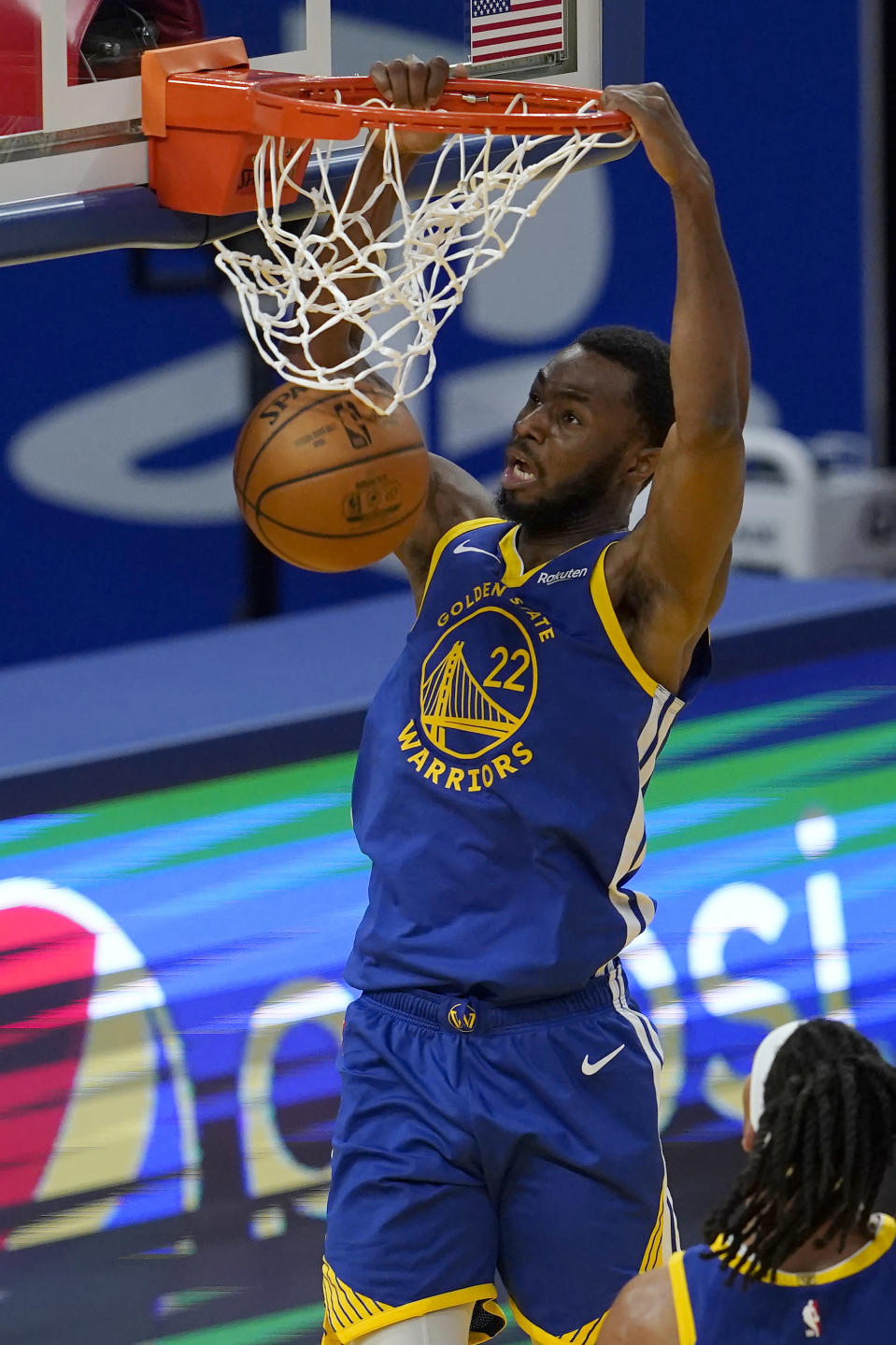 Golden State Warriors forward Andrew Wiggins (22) dunks against the Cleveland Cavaliers during the second half of an NBA basketball game in San Francisco, Monday, Feb. 15, 2021. (AP Photo/Jeff Chiu)