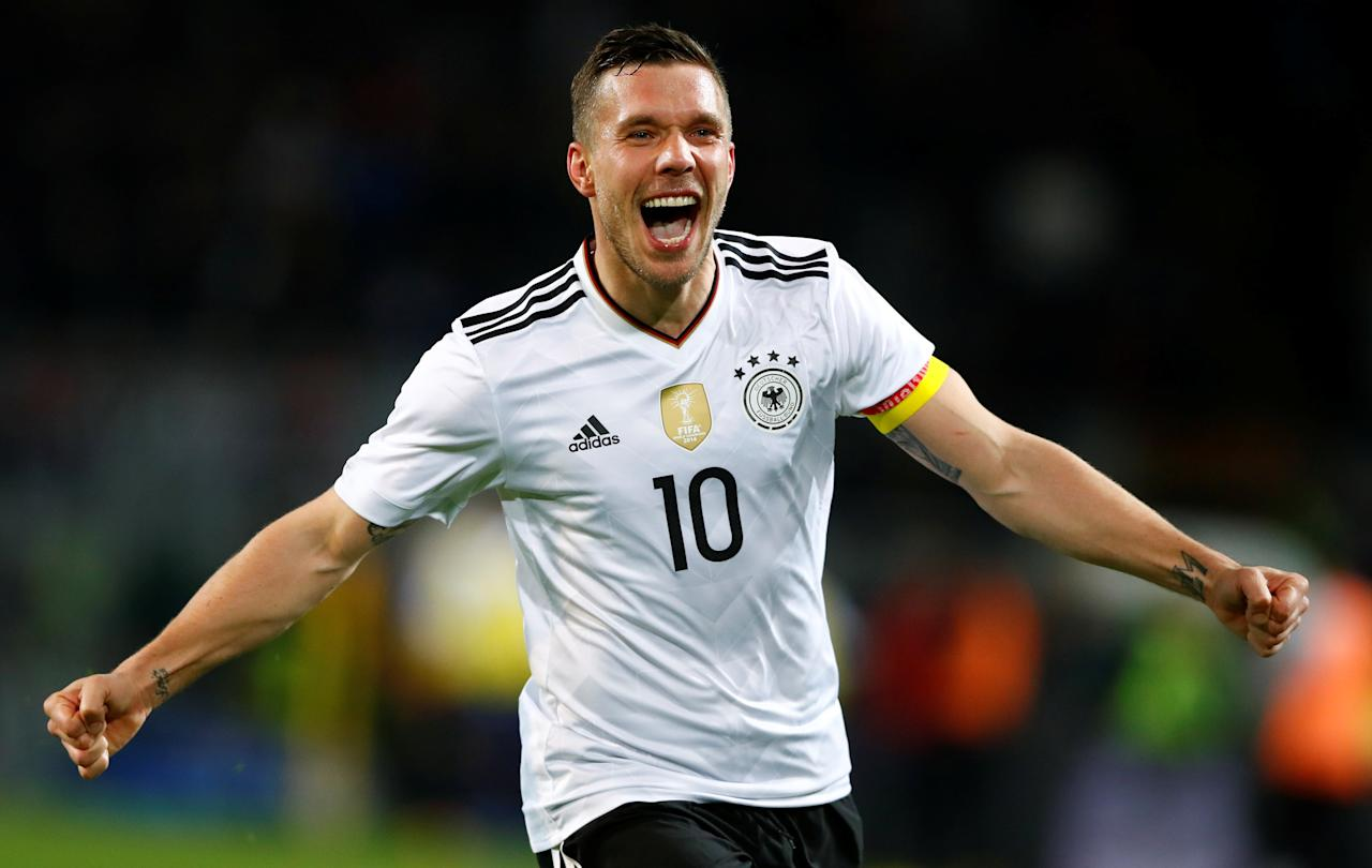 Football Soccer - Germany v England - International Friendly - Signal-Iduna-Park, Dortmund, Germany - 22/3/17 Germany's Lukas Podolski celebrates scoring his goal against England.   REUTERS/Wolfgang Rattay     TPX IMAGES OF THE DAY
