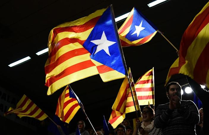 Pro-independence supporters wave Catalan flags during a campaign event in Barcelona ahead of pivotal regional elections (AFP Photo/JAVIER SORIANO)