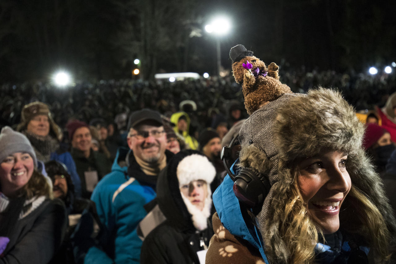 <p>A television newsperson wears a hat bearing a groundhog during ceremonies for Groundhog Day on Feb. 2, 2018 in Punxsutawney, Pa. (Photo: Brett Carlsen/Getty Images) </p>