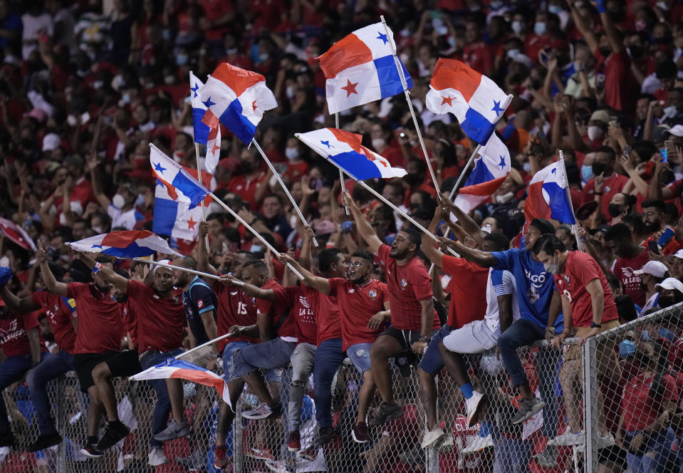 Fans of Panama celebrate the opening goal scored by Panama's Anibal Godoy against United States during a qualifying soccer match for the FIFA World Cup Qatar 2022 at Rommel Fernandez stadium, in Panama city, Panama, Sunday, Oct. 10, 2021. (AP Photo/Arnulfo Franco)
