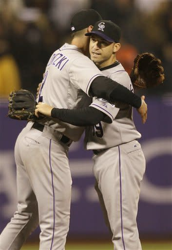 Colorado Rockies shortstop Troy Tulowitzki, left, and second baseman Marco Scutaro celebrate after the Rockies beat the San Francisco Giants in a baseball game in San Francisco, Tuesday, May 15, 2012. The Rockies won 5-4. (AP Photo/Jeff Chiu)
