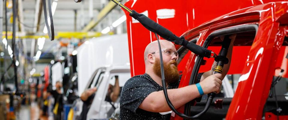 Justin Mound installs an airbag on the assembly line at GM's Chevrolet Silverado and GMC Sierra pickup truck plant in Fort Wayne, Indiana, U.S., July 25, 2018.