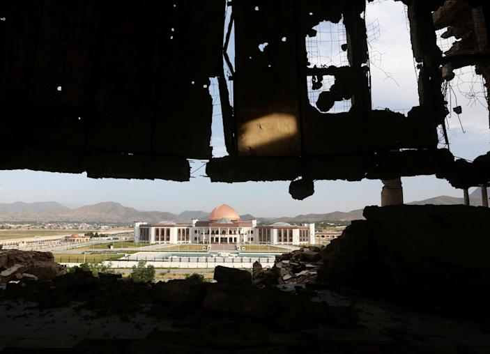 <p>Afghanistan's new parliament building is seen from the ruins of Darul Aman Palace in Kabul, Afghanistan, June 5, 2016. (Omar Sobhani/Reuters) </p>