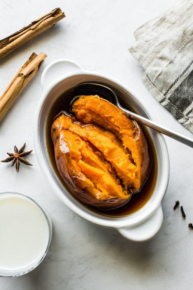 """<p>For a sweeter side dish, you'll love this recipe for <em>camotes enmielados </em>(Mexican candied sweet potatoes). The potatoes are simmered in a Dutch oven with a syrup made from piloncillo, cinnamon, star anise, and cloves.</p><p><strong>Get the recipe at <a href=""""https://www.isabeleats.com/camotes-enmielados/"""" rel=""""nofollow noopener"""" target=""""_blank"""" data-ylk=""""slk:Isabel Eats"""" class=""""link rapid-noclick-resp"""">Isabel Eats</a>.</strong></p><p><a class=""""link rapid-noclick-resp"""" href=""""https://go.redirectingat.com?id=74968X1596630&url=https%3A%2F%2Fwww.walmart.com%2Fbrowse%2Fhome%2Fdutch-ovens%2F4044_623679_8140341_7701603&sref=https%3A%2F%2Fwww.thepioneerwoman.com%2Ffood-cooking%2Fmeals-menus%2Fg36876289%2Fsweet-potato-side-dishes%2F"""" rel=""""nofollow noopener"""" target=""""_blank"""" data-ylk=""""slk:SHOP DUTCH OVENS"""">SHOP DUTCH OVENS</a></p>"""