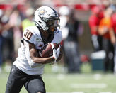 Oklahoma State's Chuba Hubbard (30) runs with the ball during the second half of an NCAA college football game against Texas Tech, Saturday, Oct. 5, 2019, in Lubbock, Texas. (AP Photo/Brad Tollefson)