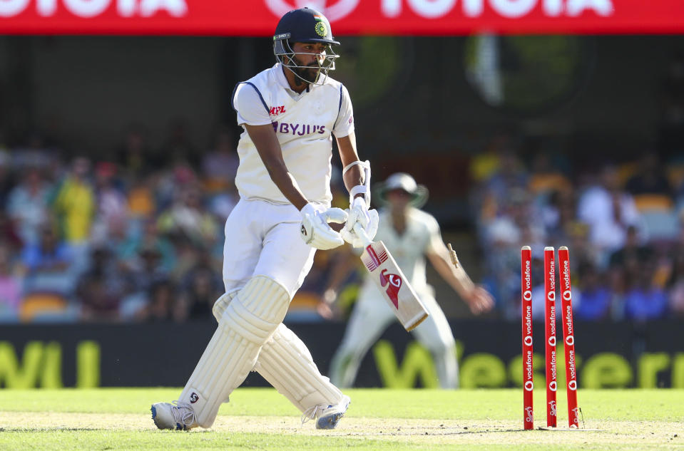 India's Mohammed Siraj is out bowled during play on day three of the fourth cricket test between India and Australia at the Gabba, Brisbane, Australia, Sunday, Jan. 17, 2021. (AP Photo/Tertius Pickard)