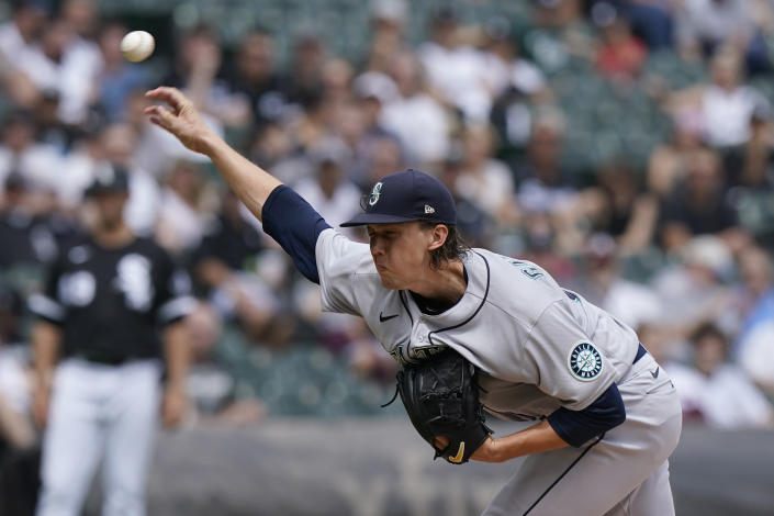 Seattle Mariners starting pitcher Logan Gilbert throws against the Chicago White Sox during the first inning of a baseball game in Chicago, Saturday, June 26, 2021. (AP Photo/Nam Y. Huh)