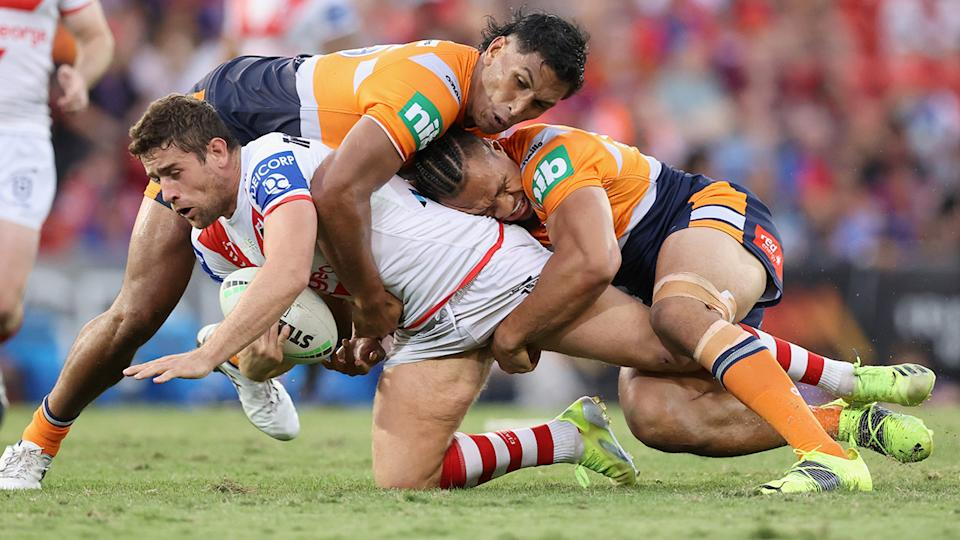 Newcastle's Jacob Saifiti, pictured laying a tackle, has copped a one match ban for a shoulder charge on Mikaeke Ravalawa. (Photo by Ashley Feder/Getty Images)
