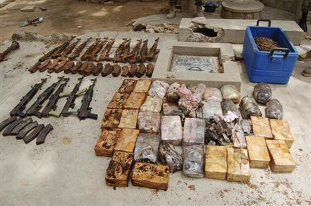 Ammunition and explosives seized from suspected members of Hezbollah are displayed after a raid of a building in Nigeria's northern city of Kano
