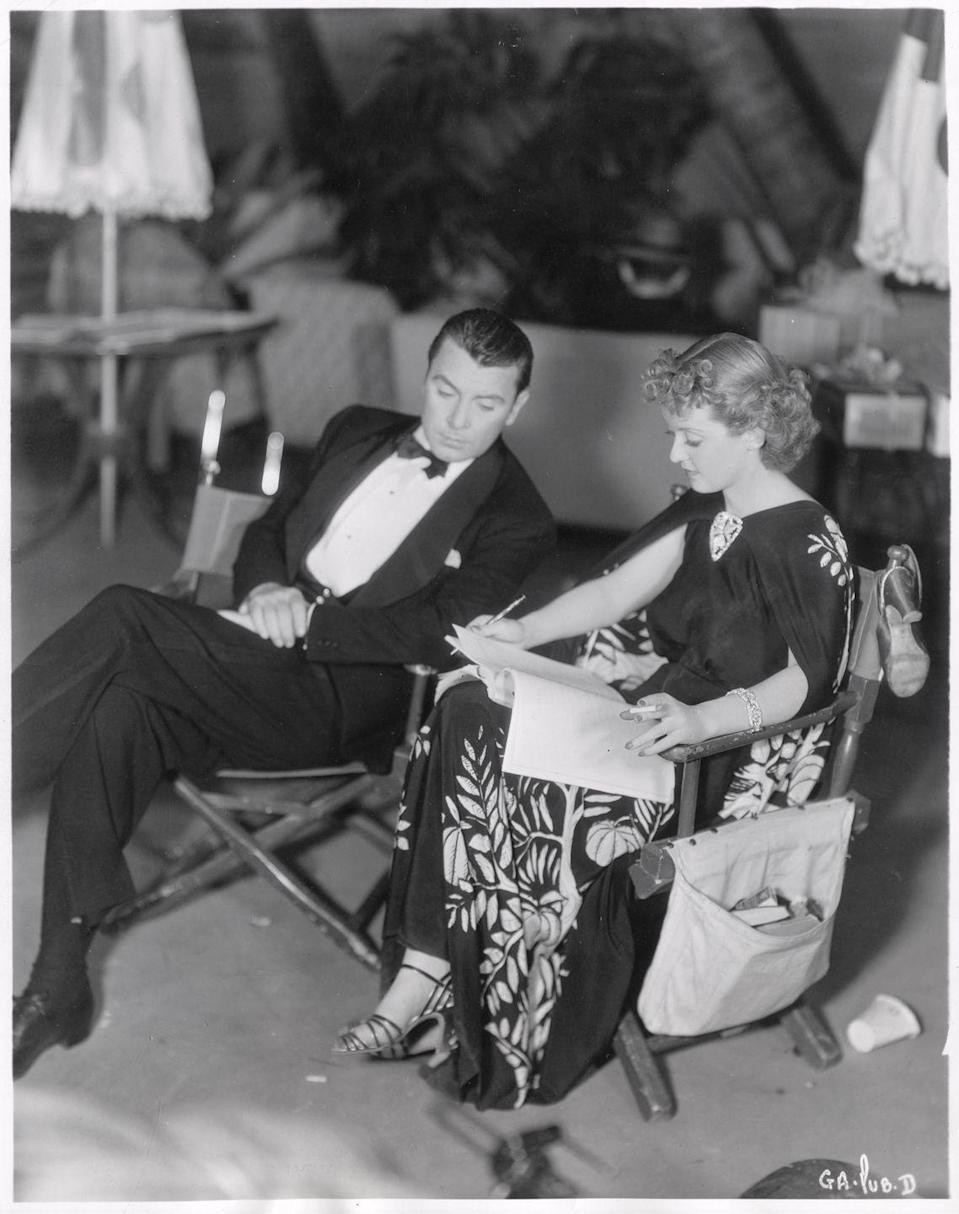 <p>Davis is pictured on set with her co-star George Brent. The pair are rehearsing their roles in <em>The Golden Arrow</em>, which was rushed into theaters despite lukewarm early reactions, because Warner Bros. was eager to capitalize on Davis's Oscar win.</p>