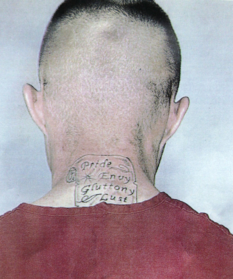 "In this photo provided by the Pierce County Sheriff's Dept., Benjamin Colton Barnes, is shown with a tattoo that reads ""Pride, Envy, Gluttony, Lust."" Officials said Barnes is a person of interest in the fatal shooting of a park ranger at Mount Rainier National Park, Sunday, Jan. 1, 2012 in Washington State. (AP Photo/Pierce County Sheriff's Dept.)"