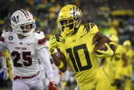 Oregon wide receiver Dont'e Thornton (10) heads to the end zone while being pursued by Stony Brook defensive back Nick Chimienti (25) during the fourth quarter of an NCAA college football game Saturday, Sept. 18, 2021, in Eugene, Ore. (AP Photo/Andy Nelson)