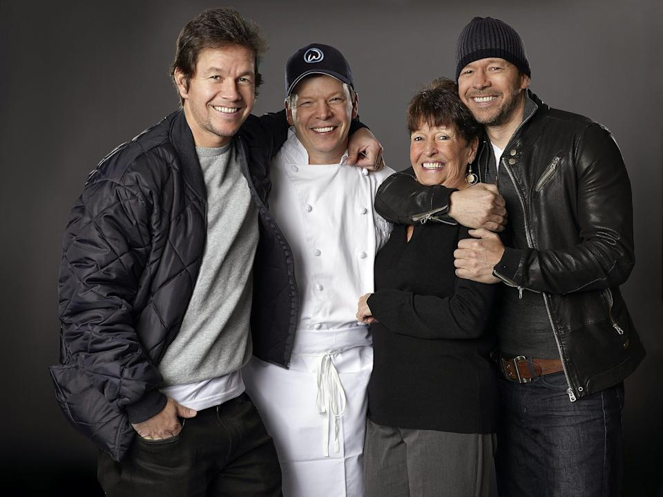 "Mark, Paul, Alma and Donnie Wahlberg starred together in the A&E series ""Wahlburgers."""
