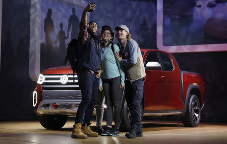 Models take a selfie as the 2019 Volkswagen Atlas pickup truck is presented at the New York Auto Show in the Manhattan borough of New York City, New York, U.S., March 28, 2018. REUTERS/Shannon Stapleton