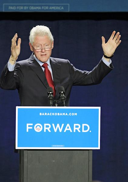 Former President Bill Clinton speaks at a campaign event for President Barack Obama, Thursday, Oct. 18, 2012, in Parma, Ohio. (AP Photo/Tony Dejak)