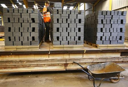 A worker checks the quality of bricks at the Wienerberger Brick Factory in Dosthill
