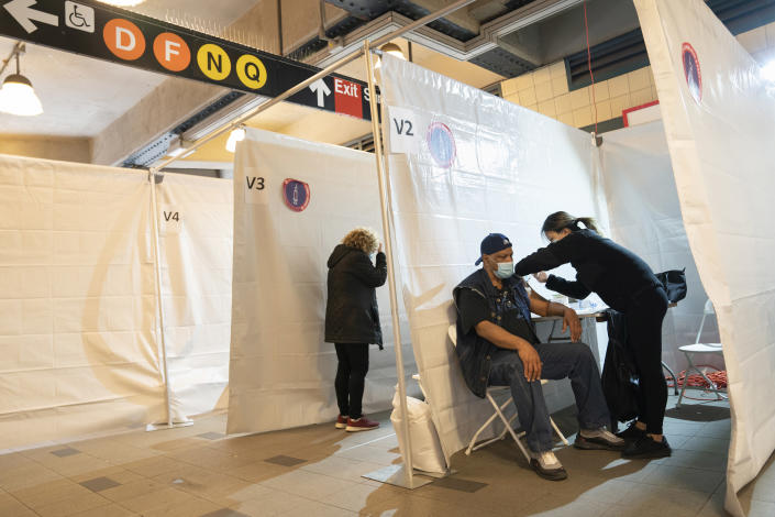 A person receives a COVID-19 vaccination at a temporary site setup in the is the Coney Island-Stillwell Ave subway station in Brooklyn on May 12, 2021. (James Estrin/The New York Times)