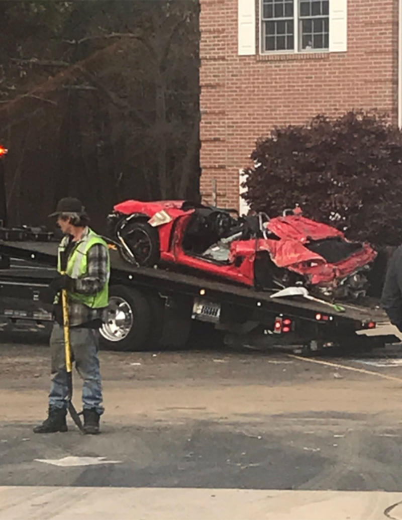 the crumbled red Porsche boxer after the crash that killed two men