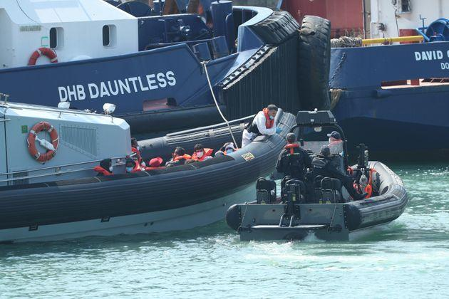 A Border Force vessel brings a group of people thought to be migrants into Dover, Kent, following a number of small boat incidents in The Channel. (Photo by Yui Mok/PA Images via Getty Images)