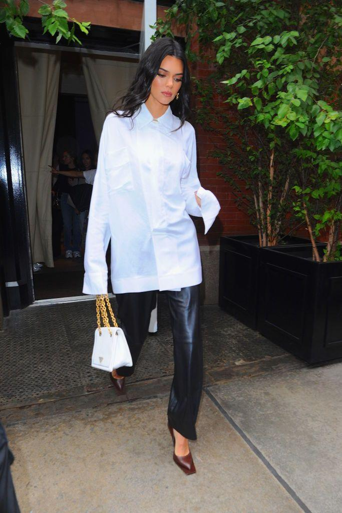 <p>Jenner ticked all the trends in an oversized shirt, leather trousers and square-toed heels.</p>