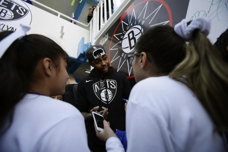The Brooklyn Nets D'Angelo Russell signs autographs and takes selfies with students during an NBA Cares event at the Maestro Miguel A. Quintana Primary School in Mexico City, Wednesday, Dec. 6, 2017. The Brooklyn Nets will play two regular season games in Mexico City, facing the Oklahoma City Thunder on Thursday, Dec. 7 and the Miami Heat on Saturday, Dec. 9. (AP Photo/Rebecca Blackwell)