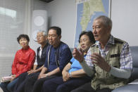 Chung Su-jin, right, speaks during an interview at a house of Shin Yun-sun, second from right, in Seoul, South Korea, Wednesday, July 29, 2020. The thousands of husbands and fathers who never returned from Sakhalin after eight decades is a largely forgotten legacy of Japan's brutal rule of the Korean Peninsula before the end of World War II. Chung, 83, and Shin, 75, are among about 400 aging relatives who hope to bring back the remains of the missing workers, seeking closure after years of emotional distress and economic hardship that affected many of the broken families( (AP Photo/Ahn Young-joon)