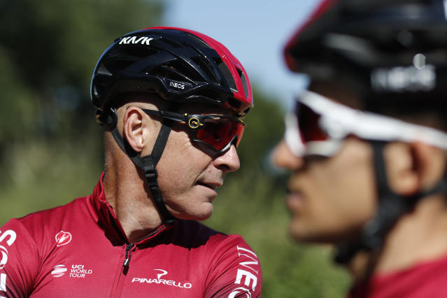 FILE - In this Thursday, July 4, 2019 file photo, Team Ineos manager Sir Dave Brailsford attends a training session in Brussels. The team of reigning Tour de France champion Egan Bernal has withdrawn from all races over the next three weeks amid the spread of the new virus outbreak and following the death of one of its sports directors. (AP Photo/Thibault Camus, File)