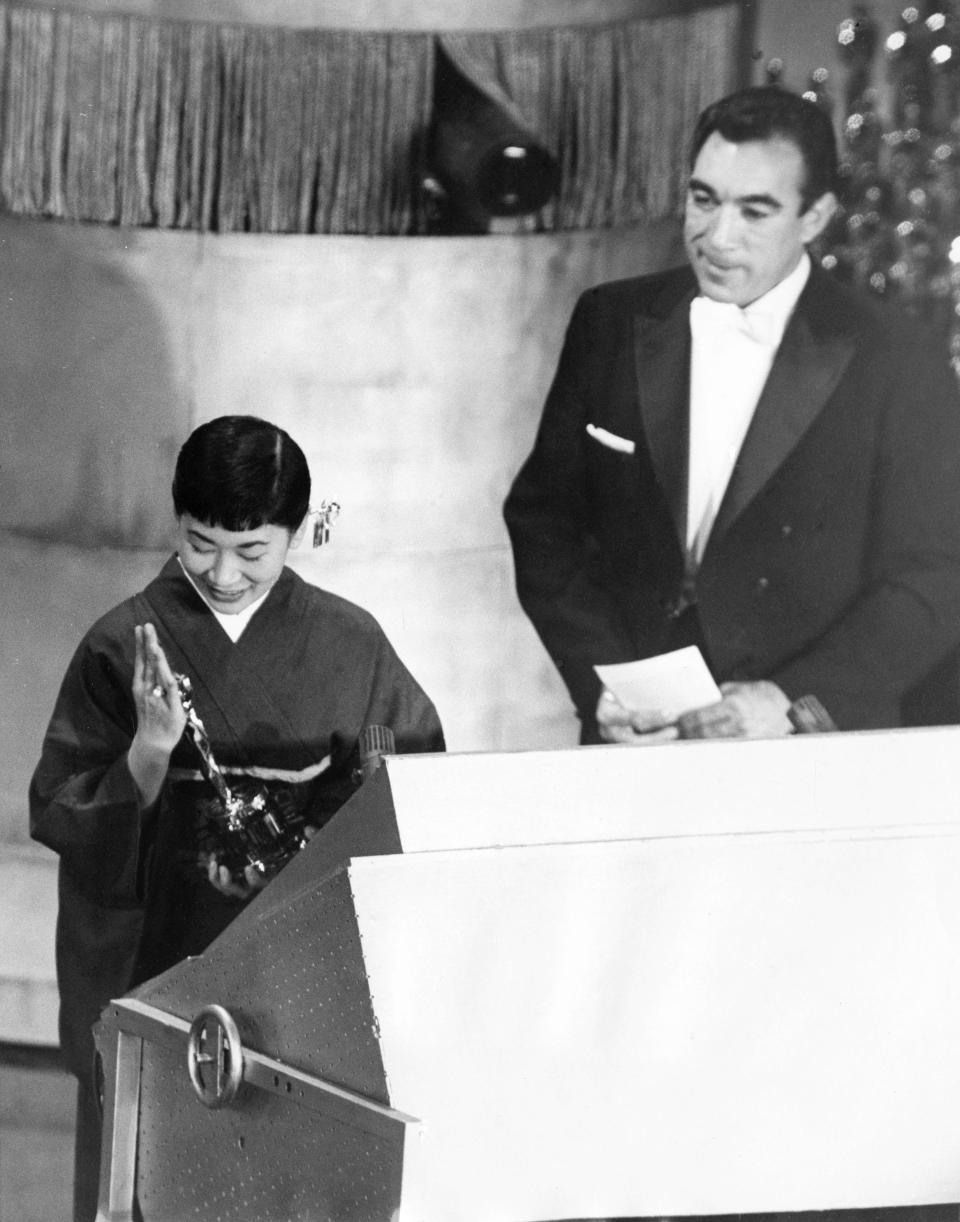 "FILE - Japanese actress Miyoshi Umeki, accepts her Academy Award for best supporting actress for her role in ""Sayonara,"" as presenter Anthony Quinn looks, during the Academy Awards ceremony in Los Angeles on March 26, 1958. Umeki was the first person from Japan to win an Oscar. (AP Photo)"