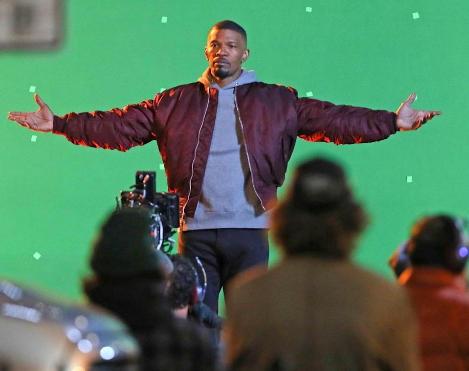<p>Jamie Foxx stands in the spotlight on the set of a music video on Tuesday in L.A.</p>
