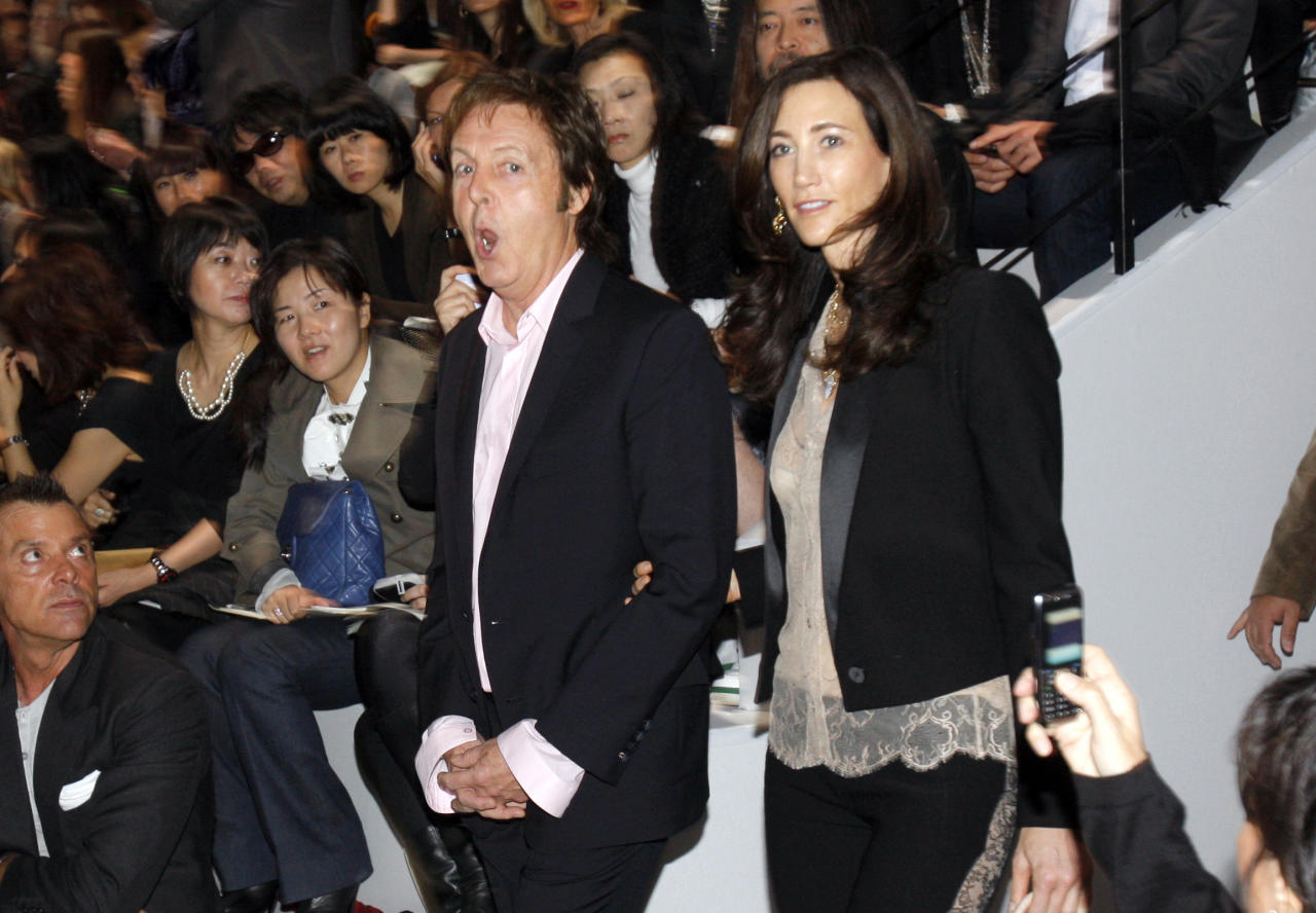 FILE - In this Monday, Oct. 5, 2009 file photo, British musician Paul McCartney, and his companion Nancy Shevell arrive for the presentation of his daughter British fashion designer Stella McCartney's Ready to Wear Spring Summer 2010 fashion collection, in Paris. McCartney turned 70 years of age Monday June 18, 2012. (AP Photo/Christophe Ena, File)
