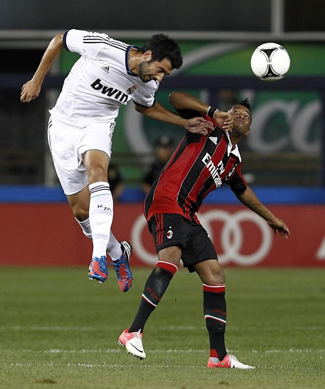 NEW YORK - AUGUST 08: Raul Albiol #18 of Real Madrid heads the ball in front Robinho #18 of A.C. Milan of during their match at Yankee Stadium on August 8, 2012 in New York City. (Photo by Jeff Zelevansky/Getty Images)