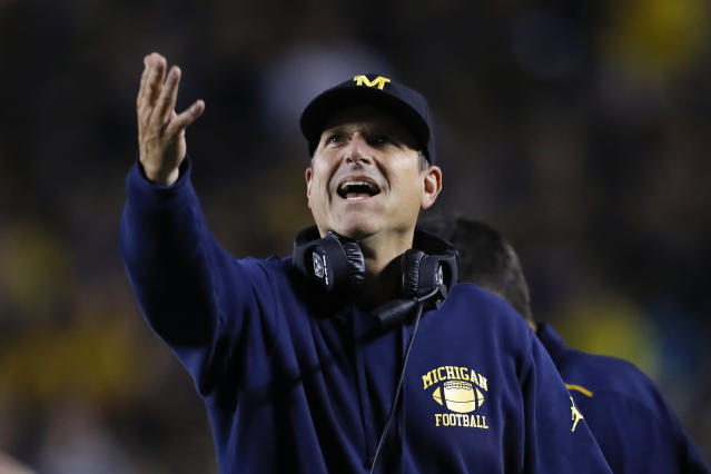 Michigan coach Jim Harbaugh argues a call during the second half of his team's game against Middle Tennessee on Saturday. (AP)