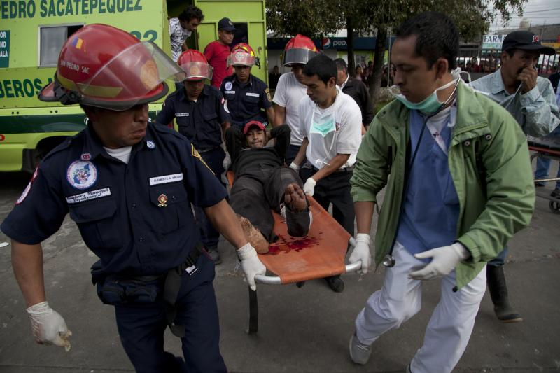 Firefighters transport a wounded resident into a public hospital after he was injured in a magnitude 7.4 earthquake that struck in San Marcos, Guatemala, Wednesday Nov. 7, 2012. The mountain village, some 80 miles (130 kilometers) from the epicenter, suffered much of the damage with some 30 homes collapsing in its center. There are three confirmed dead and many missing after the strongest earthquake to hit Guatemala since a deadly 1976 quake that killed 23,000. (AP Photo/Moises Castillo)