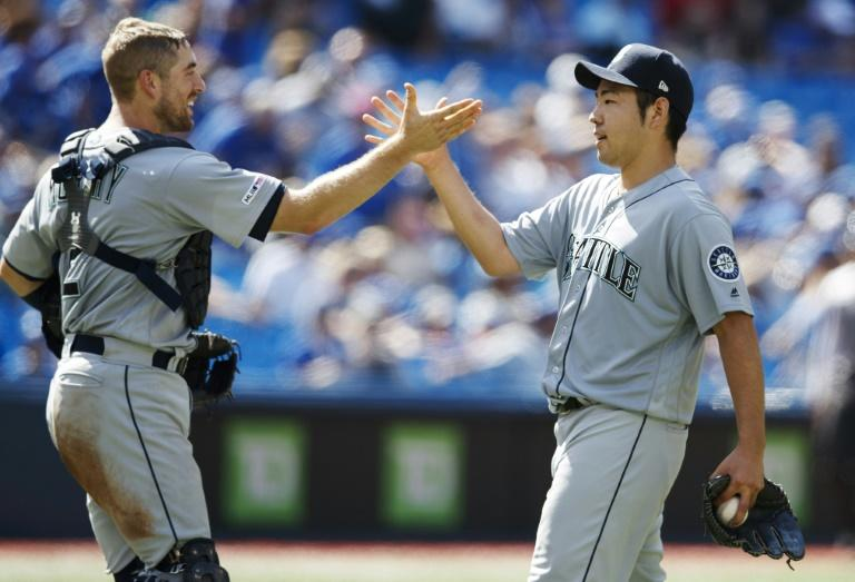 Shut-out: Seattle pitcher Yusei Kikuchi of Japan celebrates his complete game shutout with catcher Tom Murphy against the Toronto Blue Jays